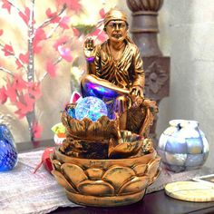 """""""Shri Sai Water Fountain (Copper Color)"""" Sai Baba Pictures, Sai Baba Photos, Gifts For Boss, Gifts For Friends, Good Morning Motivational Messages, Table Fountain, Lord Krishna Hd Wallpaper, Believe, Sai Baba Wallpapers"""