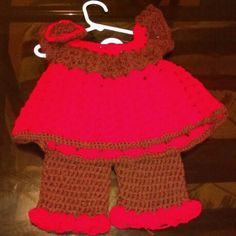 A holiday dress with red and round with pants and top