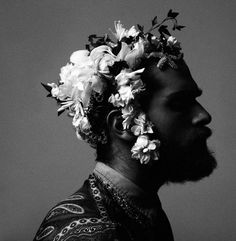 he wore flowers in his hair. x  Photographed by Stratis  Fashion editor Paolo Turina