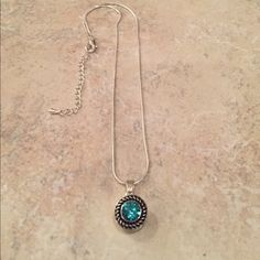 Necklace 16 inch silver plated snake chain/snap necklace with a 2 inch extender.  Comes with one turquoise blue detachable snap.  New.  Never been worn Jewelry Necklaces
