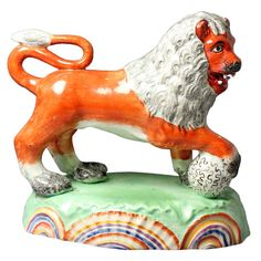 Antique Staffordshire Pottery Figure of a Lion on Beautifully Coloured Base,1820 | From a unique collection of antique and modern animal sculptures at https://www.1stdibs.com/furniture/more-furniture-collectibles/animal-sculptures/