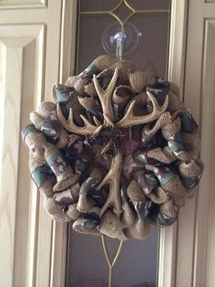 Camo and burlap antler cross wreath by Forthedoorandmore on Etsy, $40.00