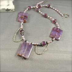 """Lilac Agate Necklace with lavender fresh water pearls, Vitrail Swarovski® crystal, faceted Czech glass and silver accents. 21"""""""
