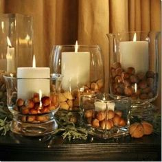 Candles filled with acorns #thanksgiving