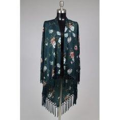 Emerald green was seen on all the runways this winter! Be fashion forward in this stunning one of a kind kimono ! Find this and much more on:  lookoftheday.com