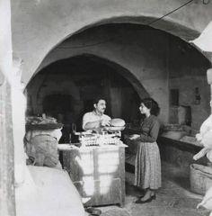 Bakery in Mykonos, Greece' by Michael J. Vamvakouri, 1950's.