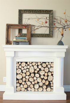 I love the mantle decoration.  No so much a big fan of the firewood.  And oh yeah, this is a FAKE fireplace.  Kind of clever.