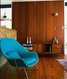 Retro Vintage living room Wooden walls, blue wool womb chair teak sideboard interior