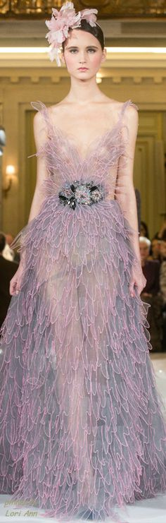 Makes me think of dragon fly wings... Less see through would be nice, but it might ruin the dress instead...  Yulia Yanina Spring 2014