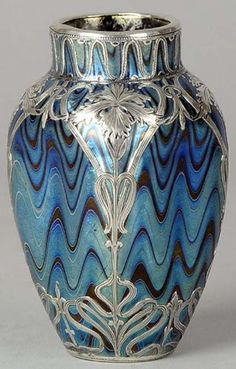 A stunning early Century Austrian glass vase of Art Nouveau dimpled form with attractive feathered blue glass and fine quality silver overlay. This vase exhibits very striking colour and detail. Glass Ceramic, Ceramic Art, Design Art Nouveau, Jugendstil Design, Deco Originale, Art Decor, Decoration, Antique Glass, Oeuvre D'art