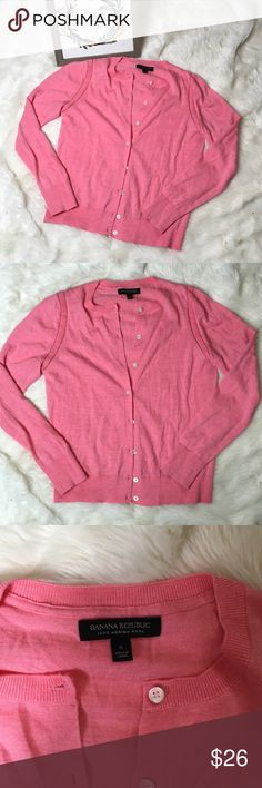Banana Republic Pink Merino Wool Cardigan Adorable salmon pink Merino wool cardigan from Banana Republic.  Small discoloration on front as shown in last pic but hardly noticeable and otherwise excellent condition.  Size small. Banana Republic Sweaters Cardigans