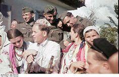 German soldiers socialise with Ukrainian women. Poltava. Ukraine. September 21, 1941