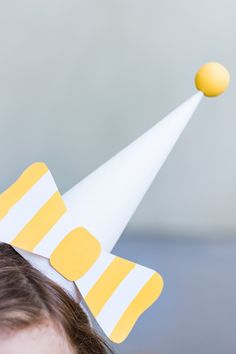DIY Striped Paper Bow Party Hats | Studio DIY®