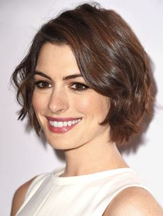 "The Swingy Bob; ""This modern bob is really wearable and flattering for women of any age, or with any face shape,"" says stylist Adir Abergel, who tends to Anne Hathaway's hair. With a classic bob, the front is one to two inches longer than the back, but you can play with those proportions—Anne Hathaway's cut is more or less the same length all around. You can customize it a million other ways, too: If you have a large forehead, side-swept bangs will downplay it. Balance a long face by making…"