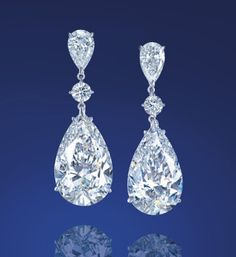 pair of pear-shaped D color, flawless Type IIa diamond ear pendants of 25.49 and 25.31 carats