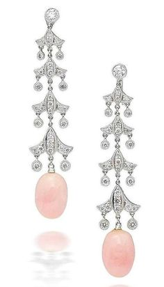 A pair of conch pearl and diamond earrings  The articulated earrings of chandelier design, the round brilliant-cut diamond surmount suspending a line of graduated fleur-de-lys motif links set with round brilliant-cut diamonds, each terminating in a conch pearl drop