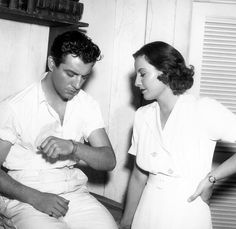 Barbara Stanwyck & Robert Taylor on set for His Brother's Wife