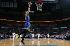 Stephen Curry of the Golden State Warriors dunks against the Oklahoma City Thunder on March 20 2017 at Chesapeake Energy Arena in Oklahoma City...