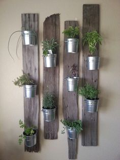Vertical Gardens indoor herb garden idea: Tin Buckets on Re-Purposed Wood - In this post, we'll share 9 beautiful ways to bring your herb garden indoors, so that you can enjoy fresh herbs all year long. Vertical Garden Planters, Vertical Gardens, Balcony Garden, Planter Garden, Small Gardens, Herb Planters, Herb Pots, Plant Pots, Outdoor Wall Planters
