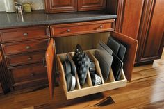 Love this idea....so many pans nowhere to store nicely