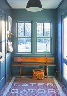 Teal blue walls and a custom penny tile floor design give this South Carolina mudroom a bit of Lowcountry flair. Decor, Penny Tile Floors, House, South Carolina Homes, Home, Contemporary Decor, Coastal Living Rooms, Interior Design, Low Country