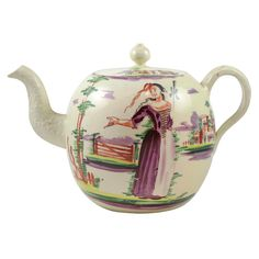 English Creamware Teapot  England  Circa 1770  A fine English creamware teapot painted in the style of David Rhoades with a woman and house