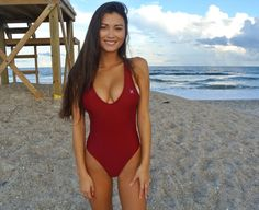 Keilah K at the beach wearing red one piece swimsuit