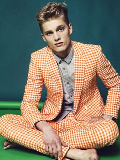Bold checkered orange suit and dandy..!