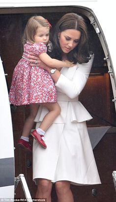 The Duchess of Cambridge carried her two-year-old daughter from the plane and down the ste...