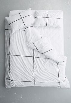Give your bedroom the makeover it deserves with the help of this minimal bedding set. It includes a duvet cover and two pillowcases, and features a stylistic grid pattern that resembles graph paper.