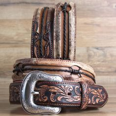 "36 "" BRIGHTON FLORAL TOOLED LEATHER 1-1/2"" WIDE MENS VINTAGE BARB BELT BROWN $150  http://www.hilasontackshop.com/pimages/picurl/84471-A.jpg  PRODUCT ID: BR-C13665-36  A mix of textures -including traditional Western motifs and rustic twisted leathe..."