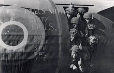 """Men of the 6th Airlanding Brigade in their Horsa glider, shortly before take-off on the 6th June. The """"Angels with dirty faces"""" remark refers to the camouflage cream that each man wore."""