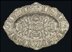 A LARGE GERMAN CARVED IVORY OVAL CHARGER