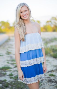 Ombre is huge for Spring! We are in love with this gorgeous, fancy-free Judith March strapless dress that has us praising the blue skies above. An easy fit with a timeless silhouette, this look is trimmed in lace!