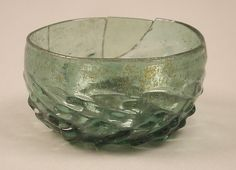The maigelein is a type of small shallow drinking bowl often molded, as here, with a pattern of intersecting ribs. It was widely produced and used in Germany and the Netherlands during the fifteenth and sixteenth centuries