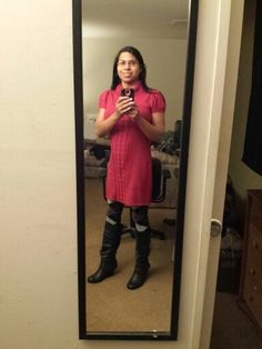 Leaving for work wearing red sweater dress, argyle tights, and boots.