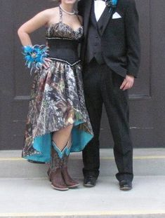 https://www.etsy.com/shop/CamoGownsAndMore Custom Made Gown for Prom 2013. Made to go with her cowboy boots! Ruched Mossy Oak Break Up Bodice fitted on top of a Black Corset Middle. Skirt is a Hi/Lo hemline...lined with turquoise  has a turquoise Lace up back. ~~~~~~~*********~~~~~~~~******** If your wanting a truly One-Of-A-Kind gown... contact me. I LOVE sewing  creating unique camo gowns. See other pics on my board for different views of this dress.
