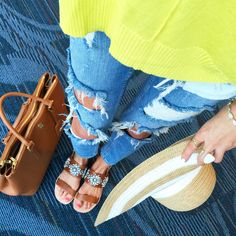 southern-curls-and-pearls:  My outfit for the plane ride to Jamaica! Here's where I got everything:yellow sweater (seriously my favorite sweater right now!) // similar jeans //Tory Burch Robinson handbag // jeweled sandals (sold out), similar here // striped sun hat //Kendra Scott ring