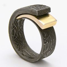 Damascus steel and 22k gold ring.  If you like this please repin, like and/or add a comment. Thanks.   Source: avantgardejewellery.co.uk  20130216 16:29