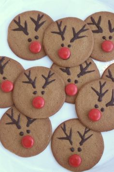 Reindeer cookies: for babysitting or for sister time!...  ....The kids also made these last December at the kids Xmas biscuit bake-off round here ;) Good fun and so easy. Gave them a food bag each with some melted choc in it, with a tiny hole cut in corner for piping. Add a red smartie or similar red sweet.