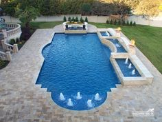 Grecian style pool with raised spa, fountains, water features. Formal