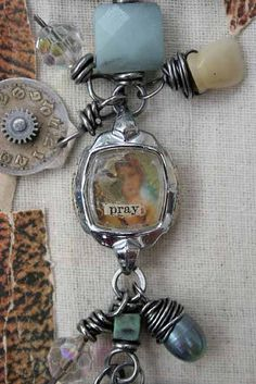 I've just got to find some old watches.  I like this vintage watch case as the center piece for a necklace.