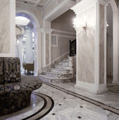 Custom marble staircase, marble inlay floors and marble walls by Decormarmi in the Grand Hotel Des Bains Riccione. http://www.decormarmi.com/en/luxurydesign/item/hotel #Luxury #Decormarmi #Marble