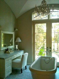 yay for garden views from the bath!  And chandeliers above the bathtub!
