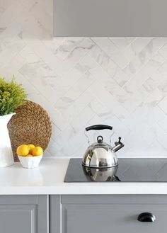 Say farewell to clunky stoves and ovens; say hello to modern living.  Samantha Pynn Kitchen for Open House Overhaul.