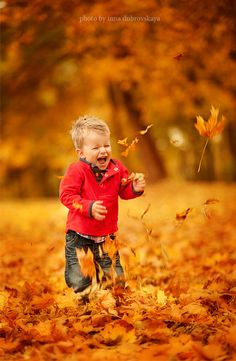 Photographer nicely captured the leaves in mid air.  Good effect.    Kids can celebrate fall like no one else.  I remember especially jumping the piles of leaves!!  #fall #autumn