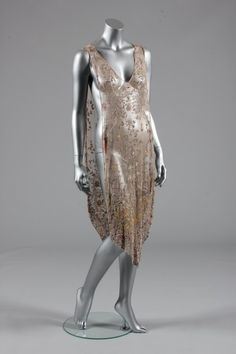 Pink beaded tulle tunic, mid 1920s, beaded and embroidered in gold thread, steel beads and pink beads, pointed hem front and back