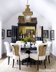 An open armoire adds interest to a dining room. Design: Dan Marty