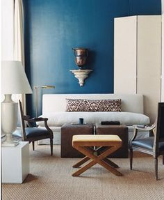 antony todd living room--folding screen, navy walls, x bench, settee, carved chair