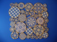 My kitchen is blue.... by woolly  fabulous, via Flickr  These were glued together and hung in a window. Love it